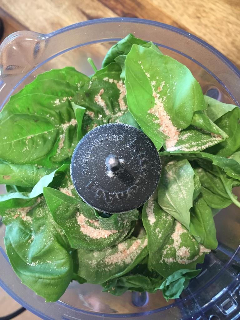 Basil and salt in food processor