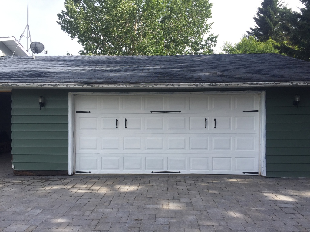 Finished garage door with accents