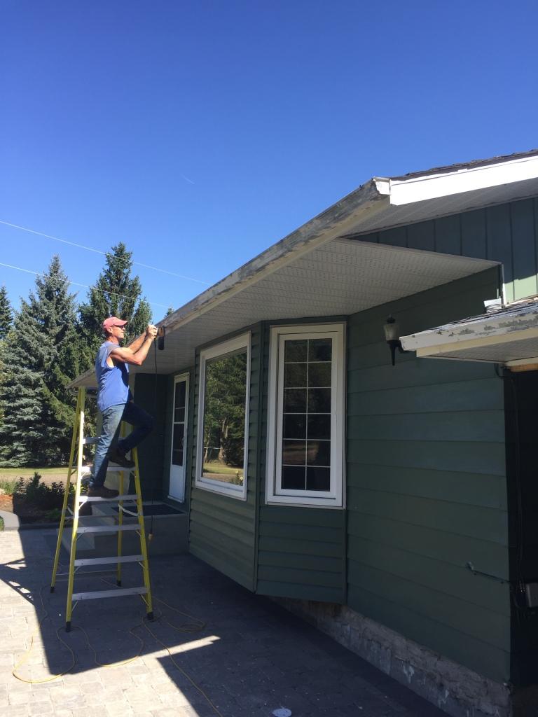 Bernd sanding down eaves