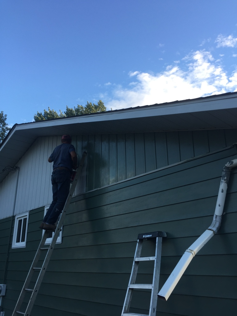 Bernd painting Gable end of house